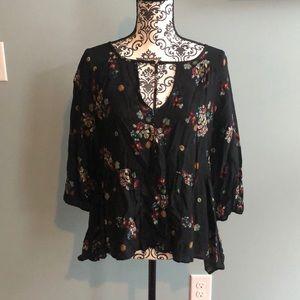 Floral blouse with unique neck line